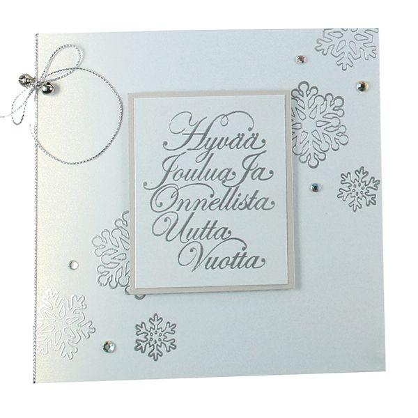 Jouluntoivotus ja lumihiutaleet on tehty korttiin värittömän leimasinmusteen ja hopeisen kohopulverin avulla.