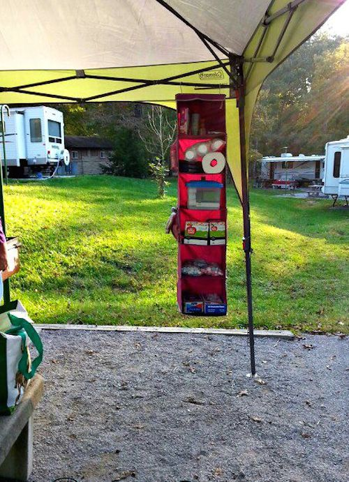 Bring a hanging organizer on a camping trip. It helps clear up space on the table. Brilliant!