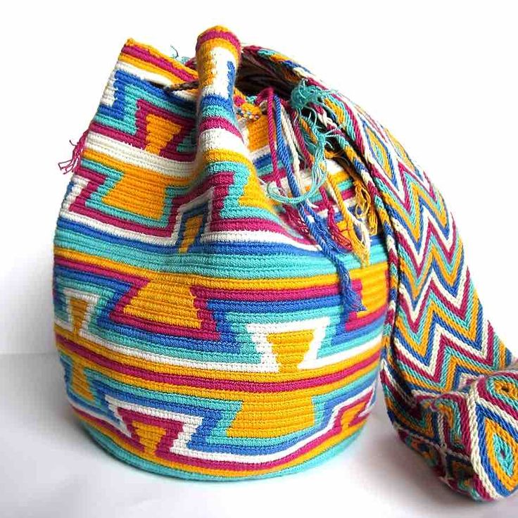 $90.00 PARROT MOCHILA. About Wayuu Mochilas: These crochet Wayuu bags are made by Wayuu women and designed by Lombia & Co. The colors of the mochilas Wayuu are inspired by the vivid colors that surround region of La Guajira. Sand, sea, desert, sun and a clear sky are constants in the landscape. Geometric figures are a signature of these mochila bags.