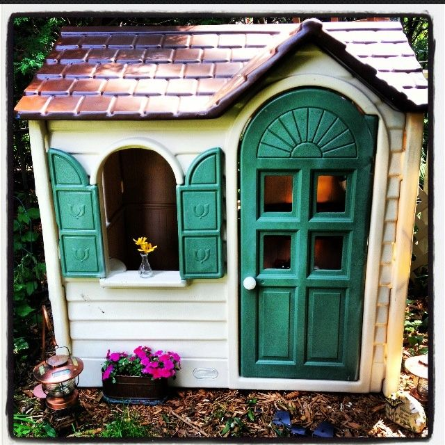 Hunter green styling turns a Little Tikes playhouse once fit for a princess into one suited for forest fairies (which are so much cooler these days anyway).