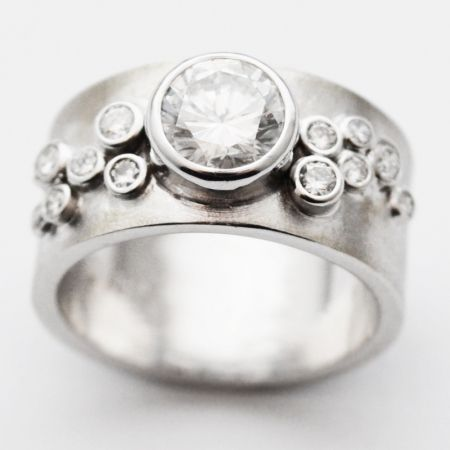 the perfect beginning to your modern fairytale!  susan west designs the most AMAZING engagement rings.  www.bluegoldsmiths.com
