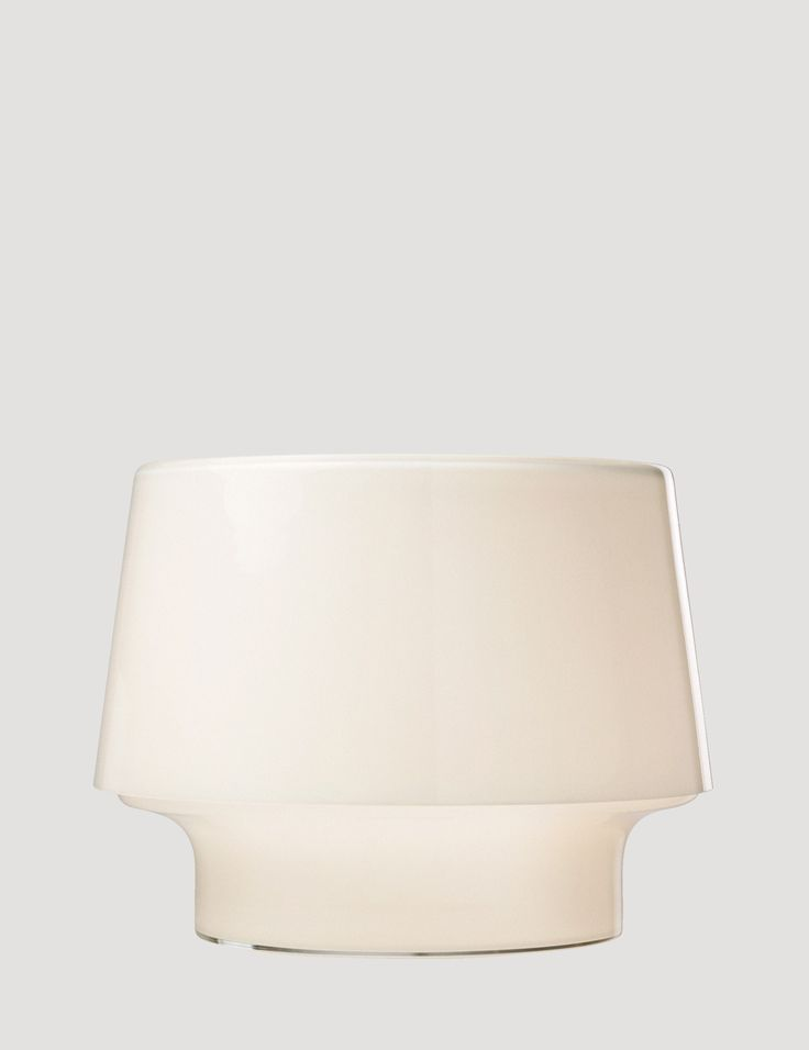 The COSY table lamp series focuses on the attractiveness of glass and the beauty of its changing reflections. Placing the light bulb at the centre of the design, the lamp is made with mouth-blown glass and comes with a textile chord. COSY can be used to add personality and atmosphere to any setting, whether on the table, shelf, or floor.