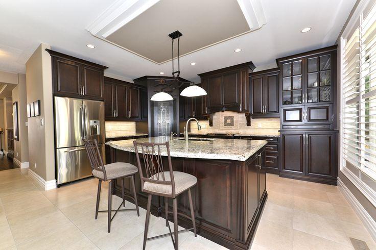 Beautiful Kitchen with dark cabinets & granite countertops #CustomHome #NewHome #Design #GourmetKitchen