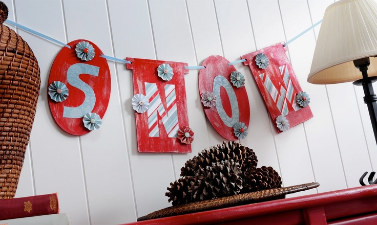 """Create a distressed """"snow"""" banner for winter with paint, Mod Podge and decorative paper."""