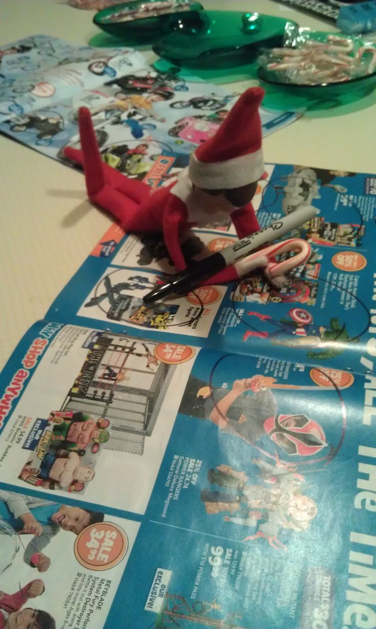 Elf on the Shelf making his own Christmas list.