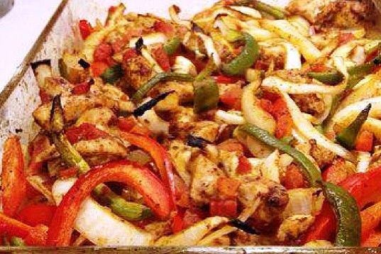I found dinner - Oven Baked Fajita  1lb chicken breasts 2 Tbsp veg oil 2 tsp chili powder 1 1/2 tsp cumin 1/2 tsp garlic powder 1/2 tsp dried oregano 1/4 tsp seasoned salt 15 oz Rotel 1 medium onion 1/2 red pepper 1/2 green pepper  Preheat oven to 400. Place chicken in 13×9 dish Combine oil, chili powder, cumin, garlic powder, dried oregano & salt Drizzle spice mixture over chicken & stir to coat Add tomatoes, peppers, & onions to the dish Bake uncovered for 20-25 mins