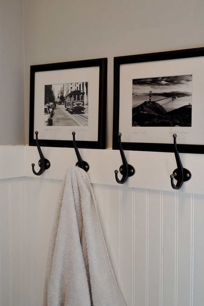 Love the beadboard, hooks and photo decor. Kinda wish we had done this instead of our double towel bar, which takes the same amount of space but holds two towels instead of four. Rock on @Kim Woodward!!