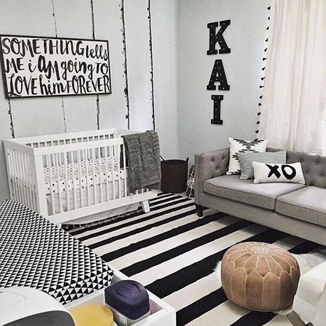 This black and white space is anything but boring. Love the couch so you can take a snooze when baby does! How do you feel about a couch in the nursery? credit: @itsallisonharlow