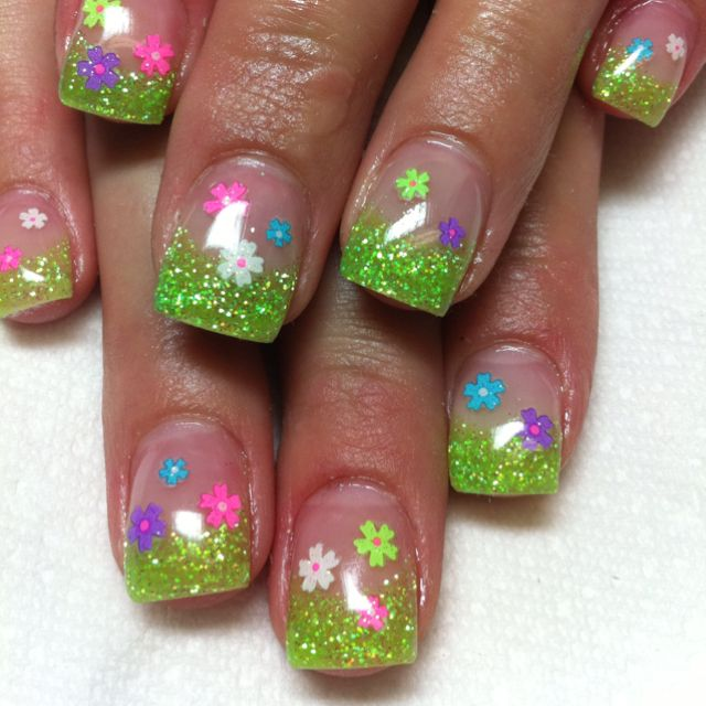 Cute green glitter french tips with flowers. Cute for Easter.