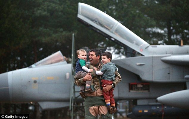 After getting out of his plane, Mr Prendergast picked up his two boys and couldn't stop sm...