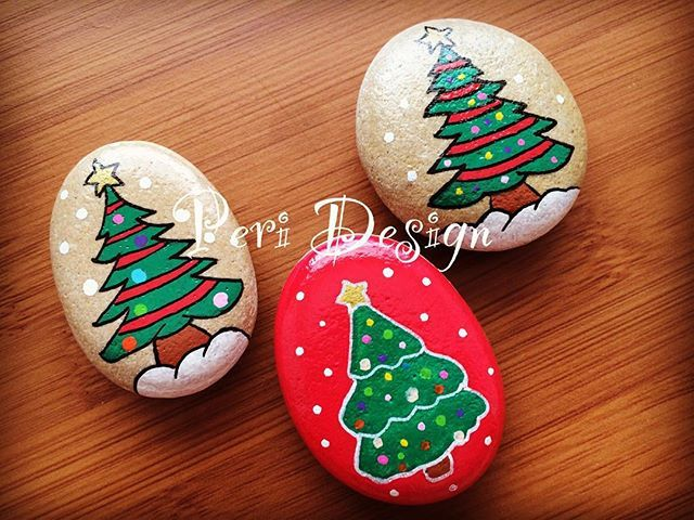 Christmas trees hand painted holiday rocks.