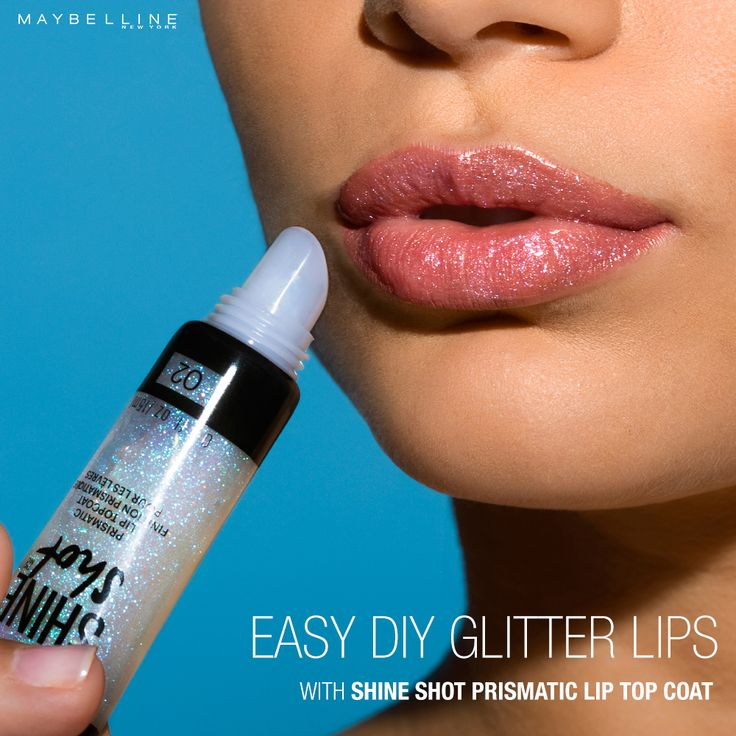 Nothing says holiday party like a little bit of  glitter! Want to get glitter lips with only one product from the drugstore? Maybelline Lip Studio Shine Shot Prismatic Lip Top Coat provides an iridescent pop of shimmer to your lips for a wearable, easy DIY glitter lip look.