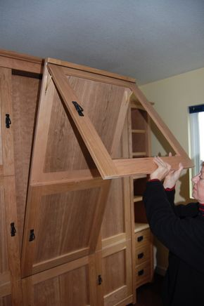 Wallbed (murphy bed) with hidden pull-down table/desk.