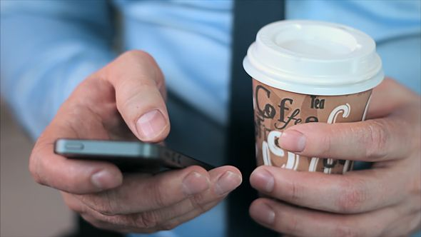 Businessman Hands with Smartphone and Coffee
