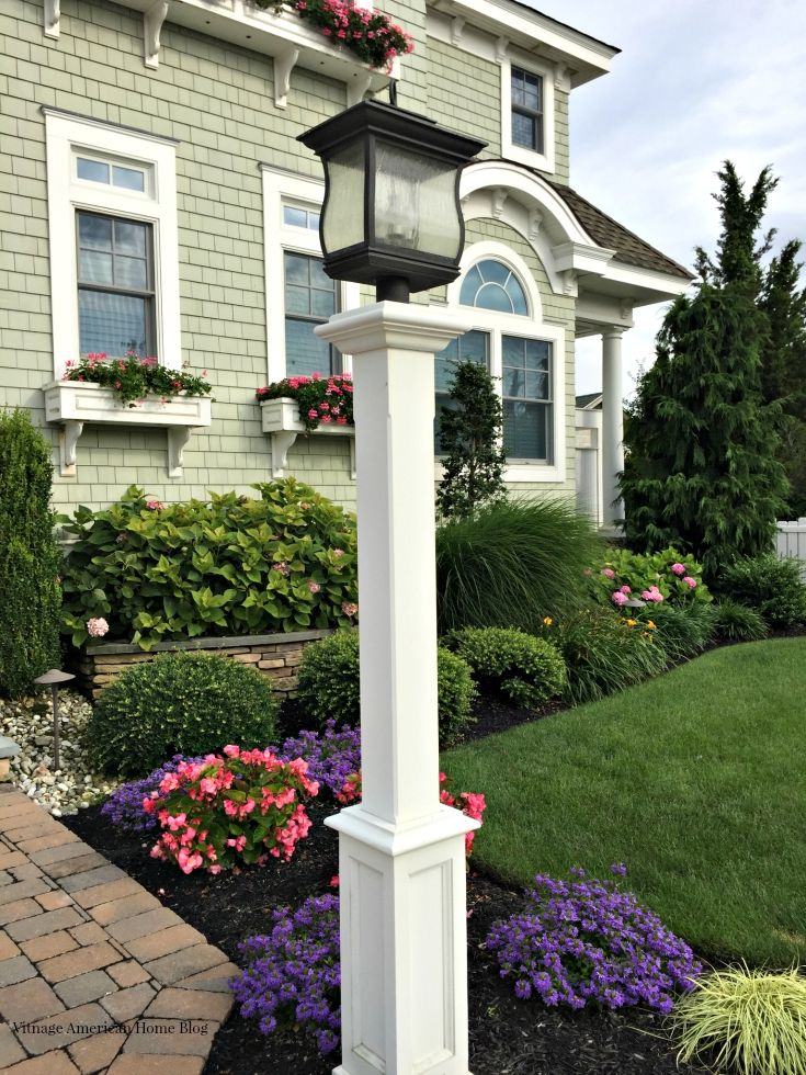 Get amazing curb appeal with 30 great ideas from Vintage American Home.  Lanterns and posts are just one idea.