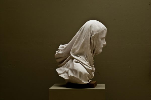 A Sculpture Titled Veiled Woman Carved Stone Draped