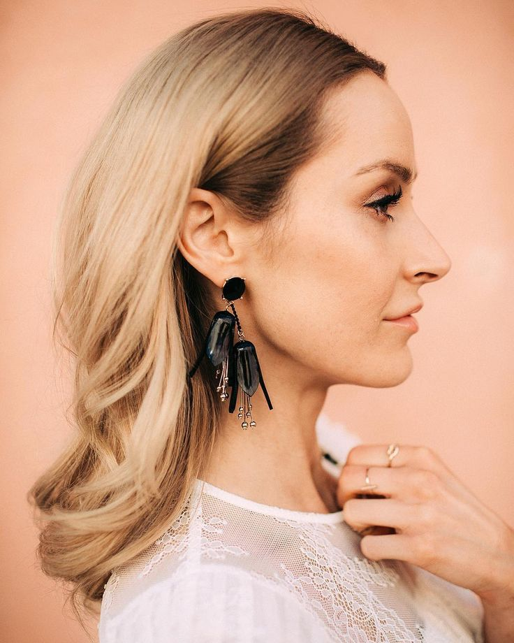 Close-up shot showing my black statement earrings in detail - Anna Pauliina, Arctic Vanilla blog. Photo by Petra Veikkola.