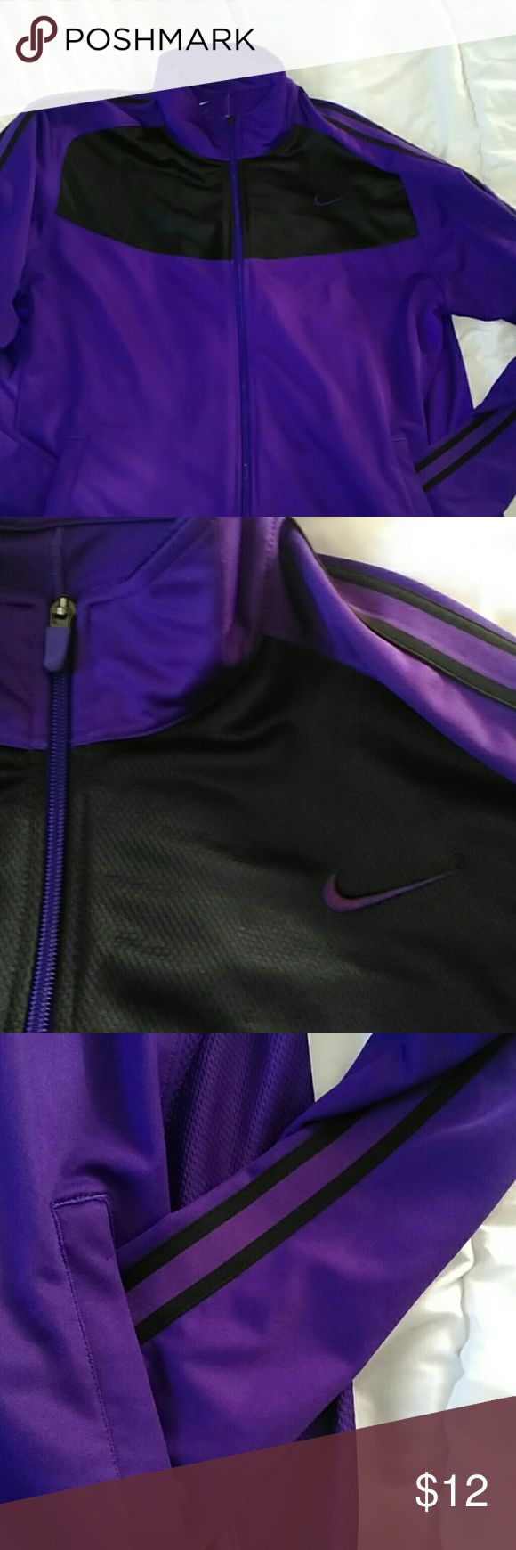Ladies Nike zip up! Size large! Hi! This is a woman's Nike zip track jacket. It's size large, the colors are a dark purple with black stripes coming down the sleeves and black going across the chest with a purple Nike sign. It has 2 front pockets. Excellent condition!!! Please let me know if you have any questions, thanks for looking, have a great day! Nike Tops Sweatshirts & Hoodies