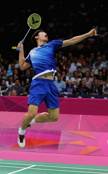 LONDON, ENGLAND - JULY 29: Yong Dae Lee of Korea returns a shot against Liliyana Natsir and Tontowi Ahmad of Indonesia during their Mixed Doubles Badminton on Day 2 of the London 2012 Olympic Games at Wembley Arena on July 29, 2012 in London, England.