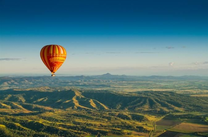 """Book your adventure - Don't miss the chance to go for a hot-air balloon ride over Far North Queensland's Atherton Tablelands - it's one of the top """"must do"""" activities when visiting the tropics. You have the choice of pick-up from Cairns, the Northern beaches or Palm Cove hotels. You'll never forget the wonder, romance and silence of watching the sun rise in Tropical North Queensland during your hot-air balloon flight"""