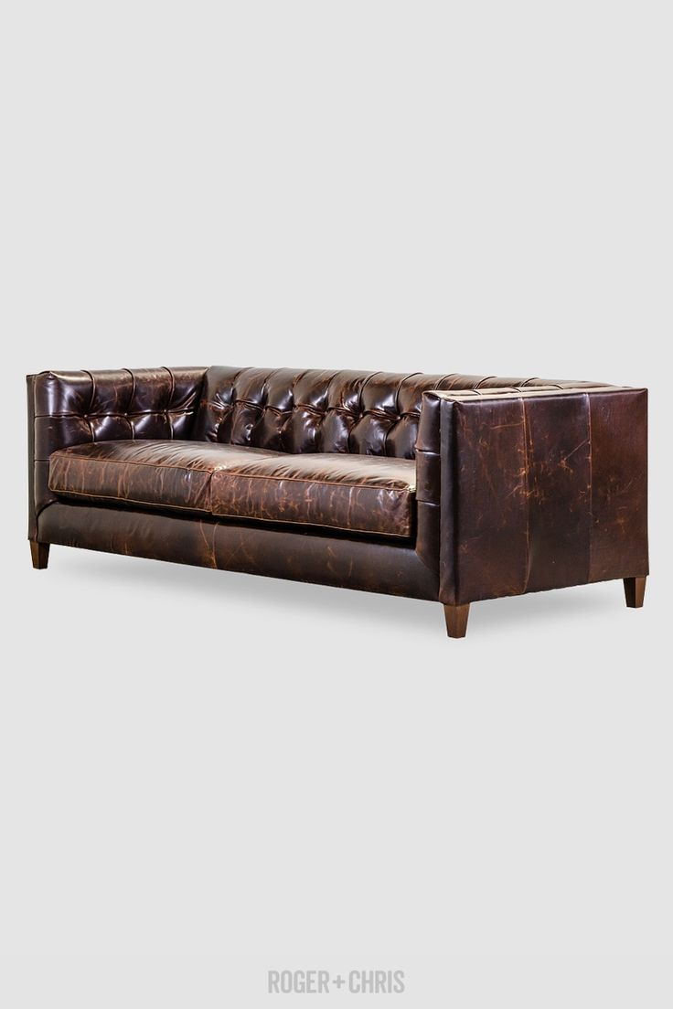 Mid-Century Modern Tuxedo Sofa in brown leather with tufting.