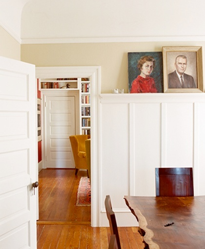 Love the portraits, the built in bookshelves, the mustard chair, and the rug!