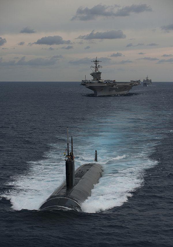 The Nimitz-class aircraft carrier USS Carl Vinson (CVN 70), the Ticonderoga-class guided-missile cruiser USS Bunker Hill (CG 52), and the Arleigh Burke-class guided-missile destroyer USS Halsey (DDG 97)