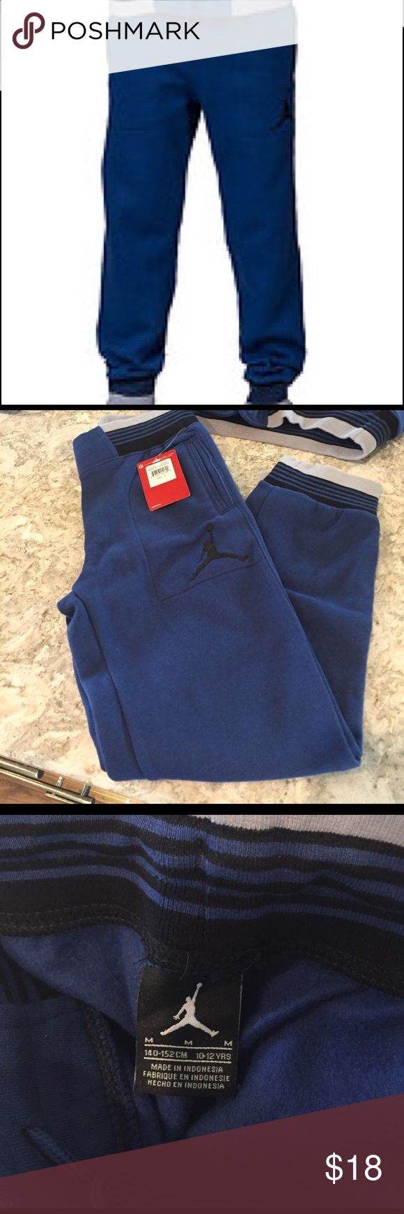 Nike Boys jumpman23 fleece lined pants 🏀 Pair with the Varsity Jacket also listed on posh for a bundle discount!  Insignia blue/black and grey Nike Bottoms