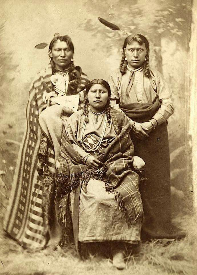 """Bismark Mary"" and Mandan men. ca. 1880."