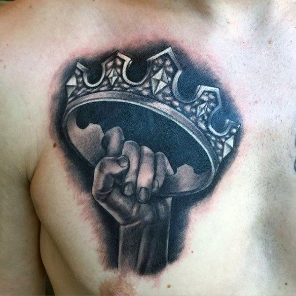Male Chest Hand Holding Crown Tattoo