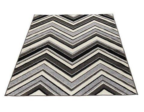 Saga-matto, musta.  Vintage -tyylinen lyhyellä nukalla oleva matto, jossa siksak -kuvionti. Materiaali pölyämätöntä polypropyleeniä.