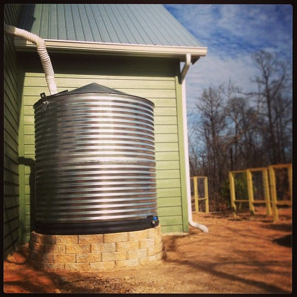 A Rain Water Collection System is a perfect way to help your garden through those tough summer months! And used correctly, they can also look like a beautiful addition to the landscape! We designed this one here to match the metal roof seamlessly!