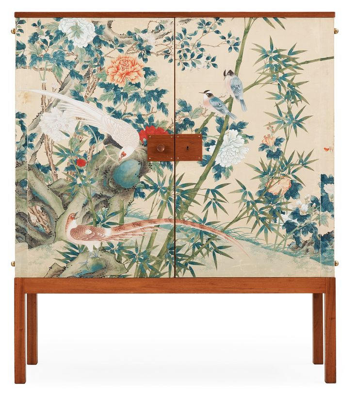 A Josef Frank mahogany cabinet, the sides and doors covered in handpainted wallpaper, Svenskt Tenn, circa 1950.