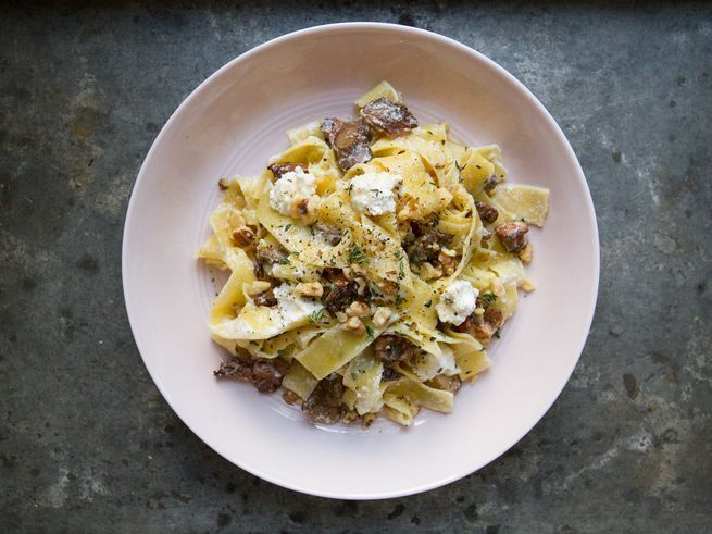 Sautéed mushrooms, toasted walnuts, ricotta, thyme, and honey combine over pappardelle for an easy pasta dish with a touch of sweetness.