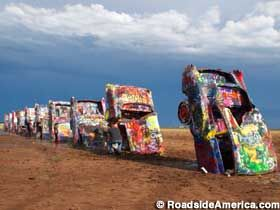 Cadillac Ranch.on Route 66 west of Amarillo, TX. It was invented and built by a group of art-hippies imported from San Francisco.