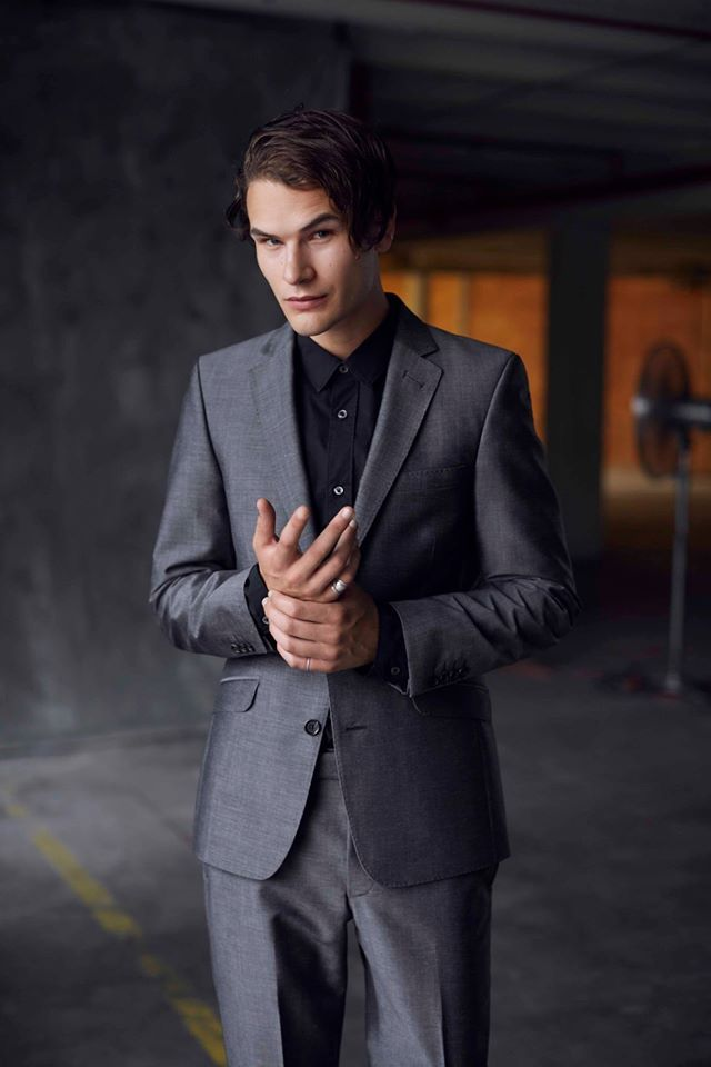 Michael Whittaker wears a Workshop Aotearoa Suit and Slim Fit Stretch Shirt