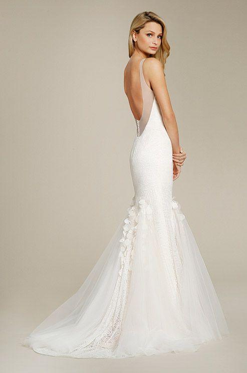 A feminine lace wedding dress by Jim Hjelm, Fall 2015