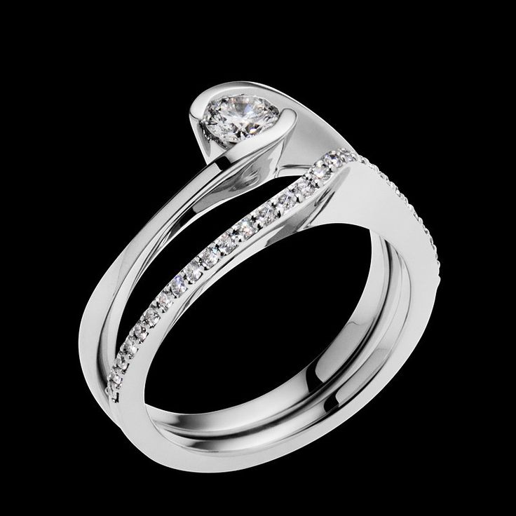 """""""Aquarius"""" is set with a 0.25, H color, SI clarity diamond, and is available in 18-karat white or yellow gold."""
