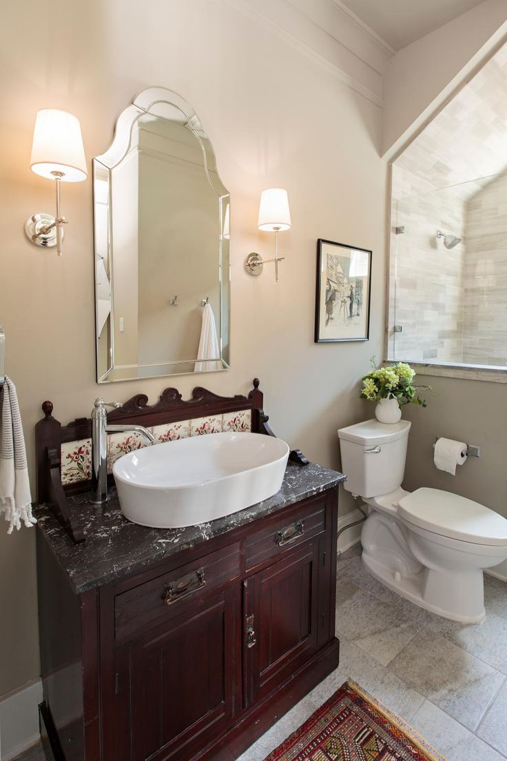 Designer Jamie House selected Craftsman details, reclaimed wood and antique accessories to help a newly constructed home fit into a historic Houston neighborhood.