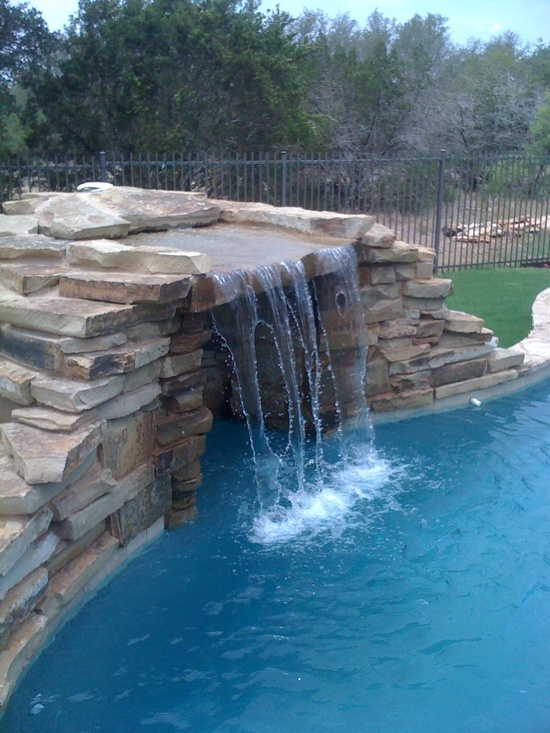 17 best images about pool waterfalls fountains and water features on pinterest the natural for Swimming pool fountains waterfalls