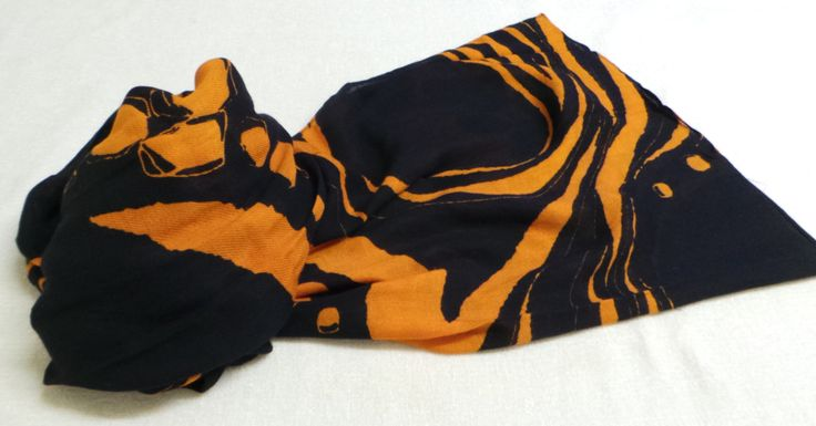 Estefan - A striking black and orange design combining circles and stripes. A beautiful cosy feeling long scarf. 100% Viscose, Scarf Size 200cm x 100cm £15.95