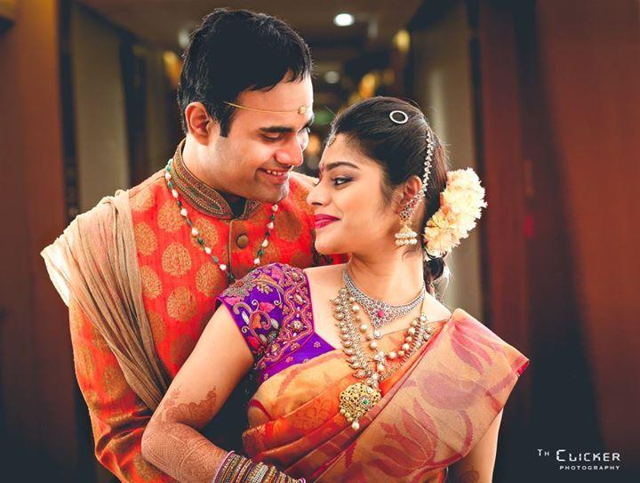 South Indian bride. Temple jewelry. Jhumkis.Orange silk kanchipuram sari with contrast blouse.Braid with fresh flowers. Tamil bride. Telugu bride. Kannada bride. Hindu bride. Malayalee bride
