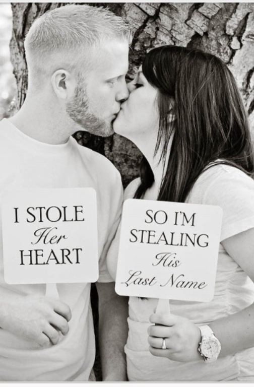 Love this!  Except I would hold the signs out and have my other arm wrapped around his neck! !:)
