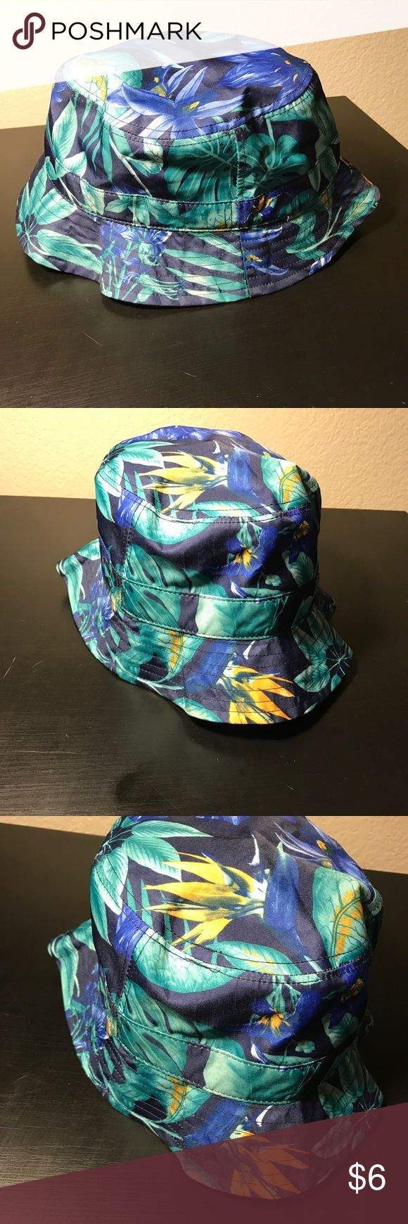 Floral Bucket Hat Floral bucket hat  Colors : Green , Blue , teal and Gold  Worn twice Accessories Hats