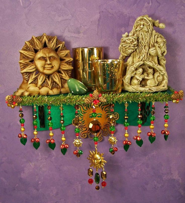 Altars:  Pagan Yule Wall #Altar. I'd like to make on with velcro on the ribbon/trim, and be able to change with the seasons/intention. Change the trim, change the statuary, etc, and good to go.