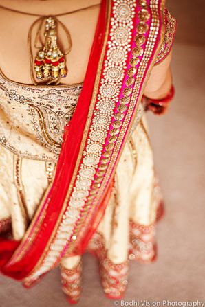 Embroidered Cream Wedding #Lehenga With Hints Of Red, Gold & Fuchsia. Photo By: Bodhi Vision Photography.
