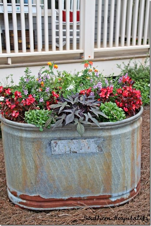 Galvanized tub planter- Great idea for raised beds. Could even do potatos, carrots, radishes, etc....... NOTE: There are NO directions to this. The link is all about style only and this pic is WAY down the page