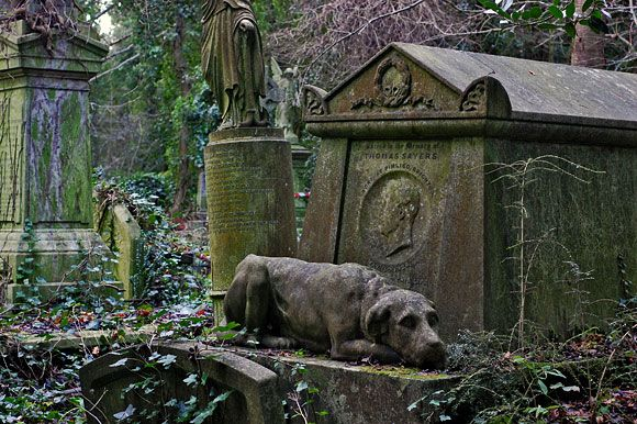 The grave of Thomas Sayers, Victorian pugilist. His pet dog rests as sculpture for eternity.
