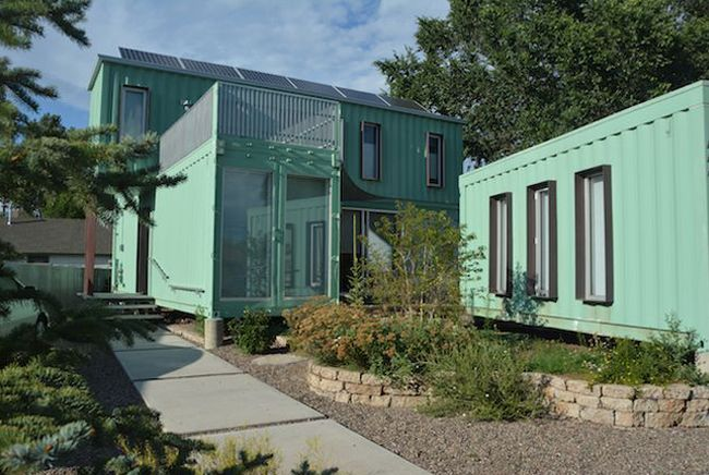 Flag The mint-green dwelling sports an industrial design, with concrete floors and a walnut finish, along with tools for collecting solar power and harvesting rainwater.