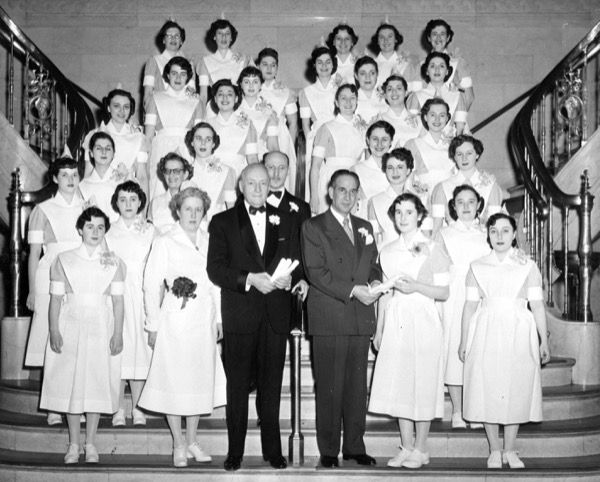 New graduated of the Beth Israel Hospital nursing school in New York. Shown with the graduating nurses are (left to right, center) Clare M. Casey, the director of nursing; Charles H. Silver, the president of Beth Israel Hospital; Dr. Maxwell S. Frank, the executive director of the institution; and Mayor Vincent Impellitteri, the principal speaker at the ceremony (1951).